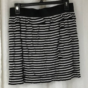 Black and white striped ruffly skirt by fire